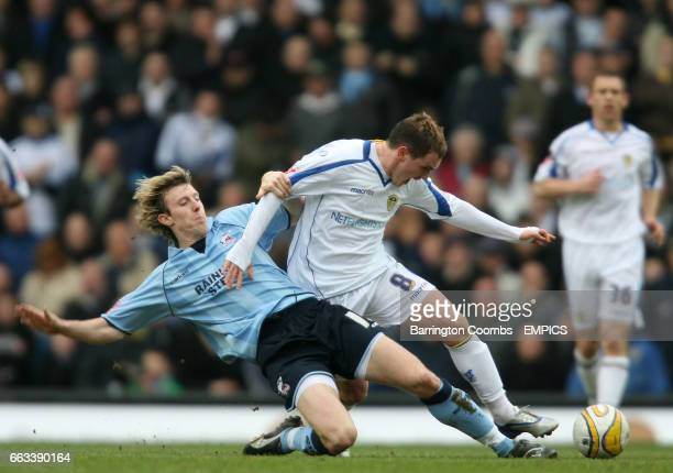 Leeds United's Neil kilkenny [R] and Scunthorpe United's Martyn Woolford