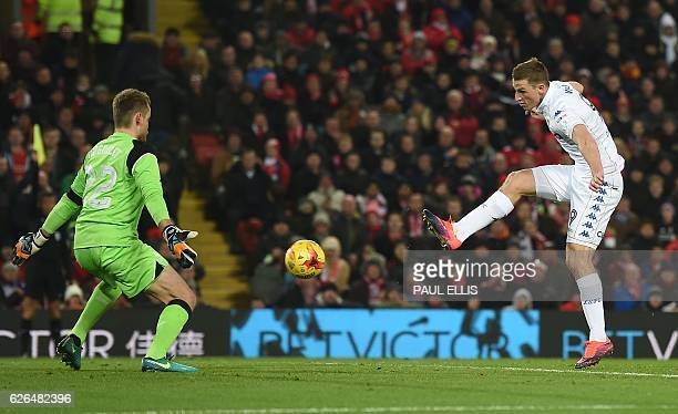 Leeds United's New Zealand striker Chris Wood shoots to score past Liverpool's Belgian goalkeeper Simon Mignolet but is ruled offside during the EFL...