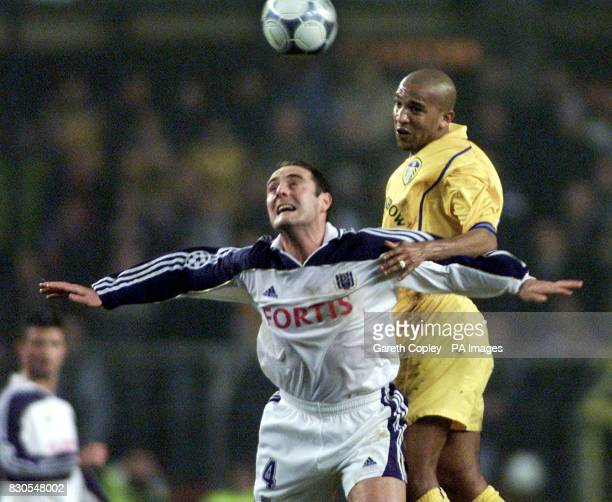 LEAGUE Leeds United's Olivier Dacourt jumps for the ball with Anderlecht's Yves Vanderhaeghe during UEFA Champions League match at the Stade Constant...