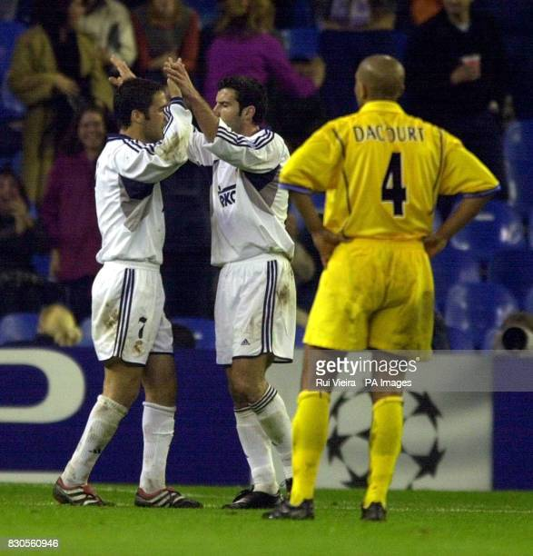 LEAGUE Leeds United's Olivier Dacourt looks in despair as Real Madrid's Raul celebrates with Figo after scoring during Champions League Group D match...