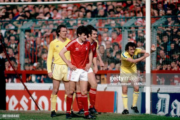 Leeds United's Paul Madeley and Kevin Hird keep an eye on Nottingham Forest's Garry Birtles and Larry Lloyd as they wait for a corner