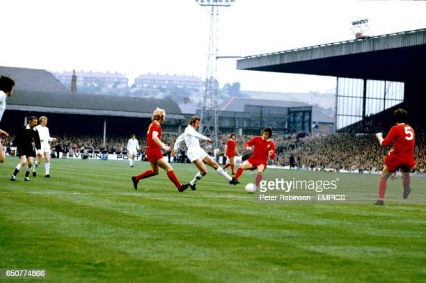 Leeds United's Paul Madeley shoots for goal watched by Liverpool's Alec Lindsay and Ian Callaghan