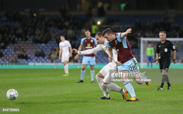 Leeds United's PierreMichel Lasogga and Burnley's Kevin Long battle for the ball during the Carabao Cup third round match at Turf Moor Burnley