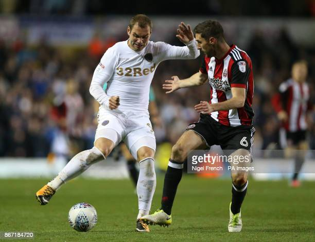 Leeds United's PierreMichel Lasogga and Sheffield United's Chris Basham battle for the ball during the Sky Bet Championship match at Elland Road Leeds