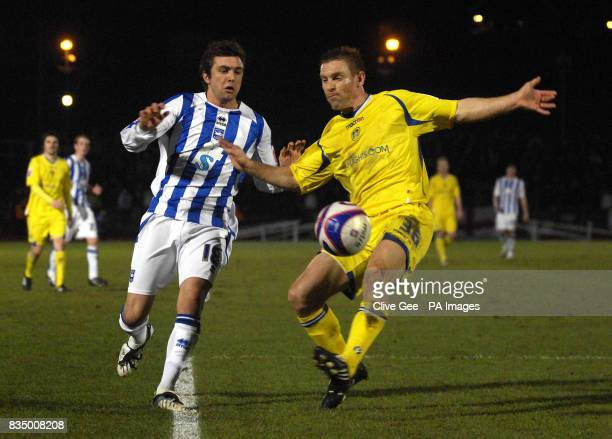 Leeds United's Richard Naylor holds off Brighton and Hove Albion's Doug Loft during the CocaCola Football League One match at the Withdean Stadium...
