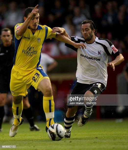 Leeds United's Robert Snodgrass and Darlington's Gary Smith battle for the ball
