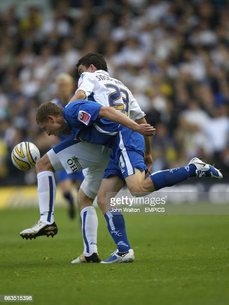 Leeds United's Robert Snodgrass and Millwall's David Martin battle for the ball
