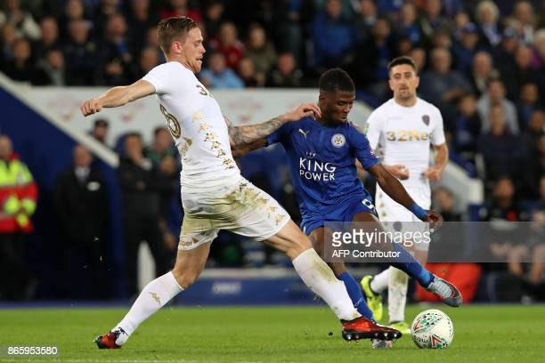 Leeds United's Swedish defender Pontus Jansson tries to block an attempt from Leicester City's Nigerian striker Kelechi Iheanacho during the English...