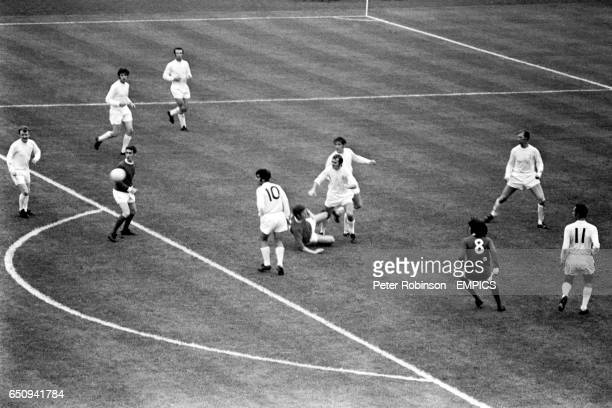 Leeds United's Terry Cooper and Norman Hunter clear from Manchester United's Brian Kidd watched by teammates Billy Bremner Peter Lorimer Paul Reaney...