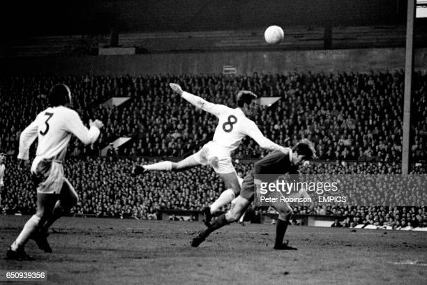 Leeds United's Terry Cooper looks on as teammate Paul Madeley heads clear from Liverpool's Emlyn Hughes
