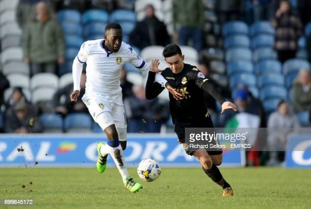 Leeds United's Toumani Doukara holds off Bolton Wanderers' Zach Clough