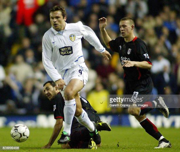 Leeds's Mark Viduka gets past Fulham's Sean Davis and Sylvain Legwinski during their Barclaycard Premiership match at Elland Road Leeds 02/07/04...