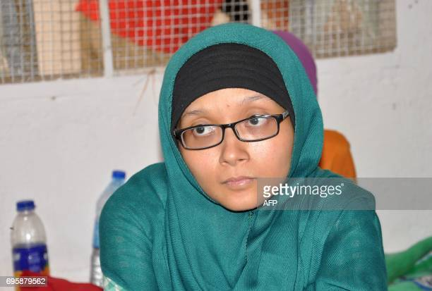 Leefa an Indonesian woman sits in a room following her arrival at the Ain Issa camp 50 kilometres north of Raqa after fleeing the Islamic State...