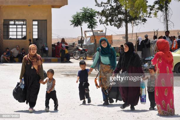 Leefa arrives at the Ain Issa camp 50 kilometres north of Raqa with other Indonesians after fleeing the Islamic State group's Syrian bastion on June...