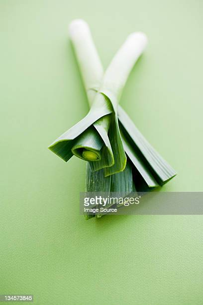 Leeks against green background