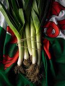 bunch of fresh leeks on the Welsh flag