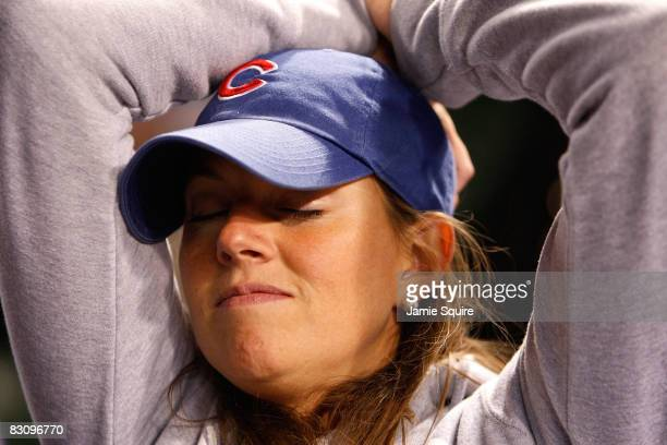 Leela Sullivan a fan of the Chicago Cubs looks on dejected as they Cubs lost 103 against the Los Angeles Dodgers in Game Two of the NLDS during the...