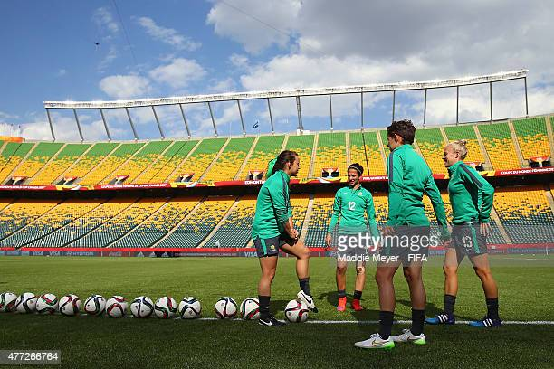 Leena Khamis of Australia Tameka Butt Hayley Raso and Ashleigh Sykes talk together before a training session at Commonwealth Stadium on June 15 2015...