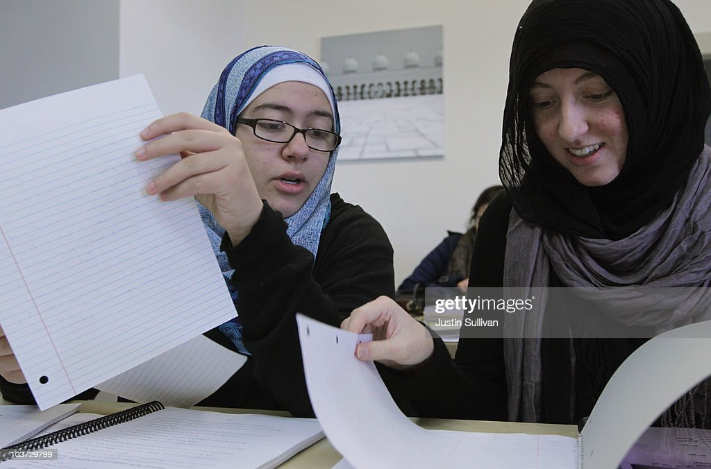 Leenah Safi (L) and Sumaya Mehai look over paperwork between classes at Zaytuna College August 30, 2010 in Berkeley, California. Zaytuna College opened its doors on August 24th and hopes to become the first accredited four-year Islamic college in the United States. The school was founded by three Muslim-American scolars and offers degrees in Islamic law, theology and Arabic languages. Fifteen students are enrolled in the inaugural class and the school hopes to increase that number to 2,200 within ten years.
