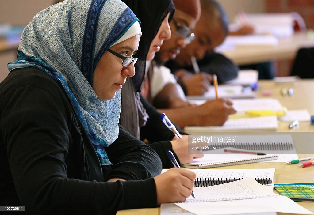 Leenah Safi (L) looks on during a lecture at Zaytuna College August 30, 2010 in Berkeley, California. Zaytuna College opened its doors on August 24th and hopes to become the first accredited four-year Islamic college in the United States. The school was founded by three Muslim-American scolars and offers degrees in Islamic law, theology and Arabic languages. Fifteen students are enrolled in the inaugural class and the school hopes to increase that number to 2,200 within ten years.