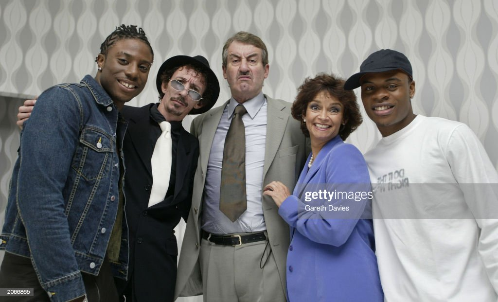 Lee-O, Patrick Murray, John Challis, Sue Holderness and Ginja on the set of the video for Ginja and Lee-O's single 'Del Boy's Theme', London on September 19 2002. The song samples the theme tune to the popular sitcom 'Only Fools and Horses' in which Patrick, John and Sue played Mickey Pearce, Boycie and Marlene respectively.