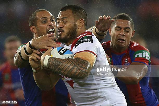 Leeson Ah Mau of the Dragons is tackled by Dane Gagai and Jeremy Smith of the Knights during the round five NRL match between the Newcastle Knights...