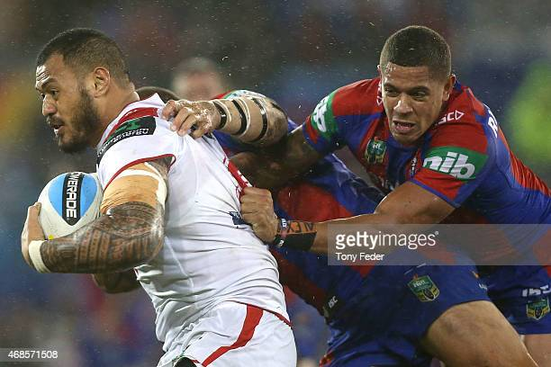 Leeson Ah Mau of the Dragons is tackled by Dane Gagai of the Knights during the round five NRL match between the Newcastle Knights and the St George...