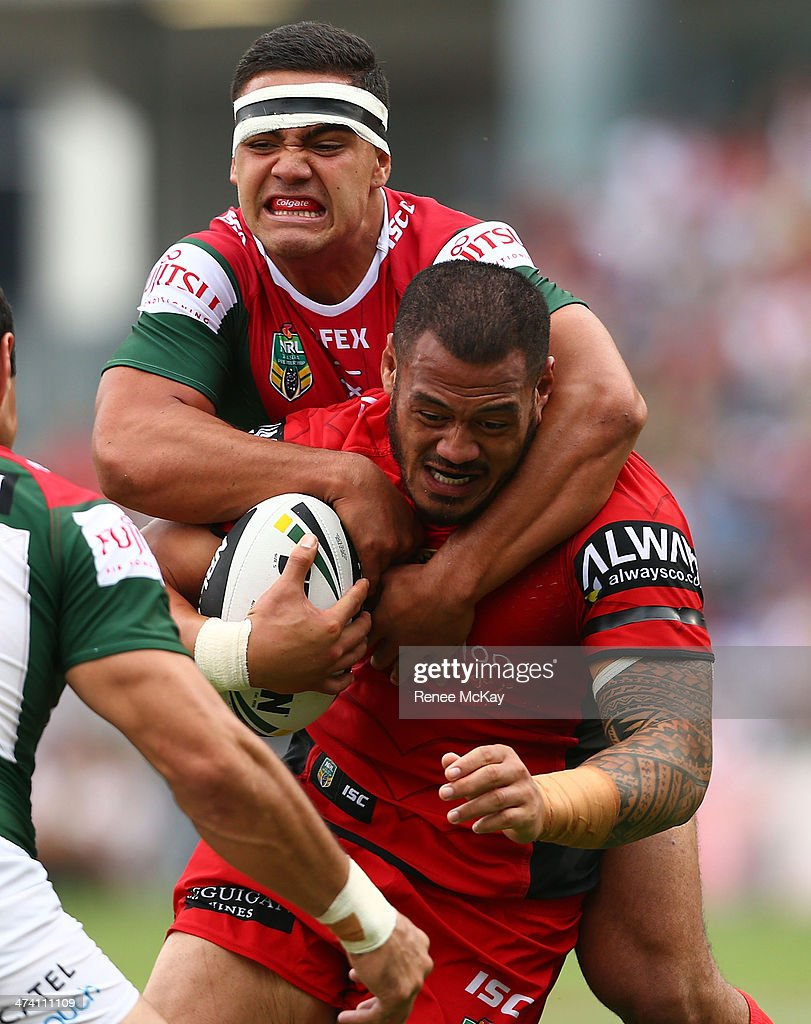 Leeson Ah Mau of the Dragons is tackled by Dylan Walker during the NRL Charity Shield match between the South Sydney Rabbitohs and the St George Dragons at WIN Stadium on February 22, 2014 in Wollongong, Australia.