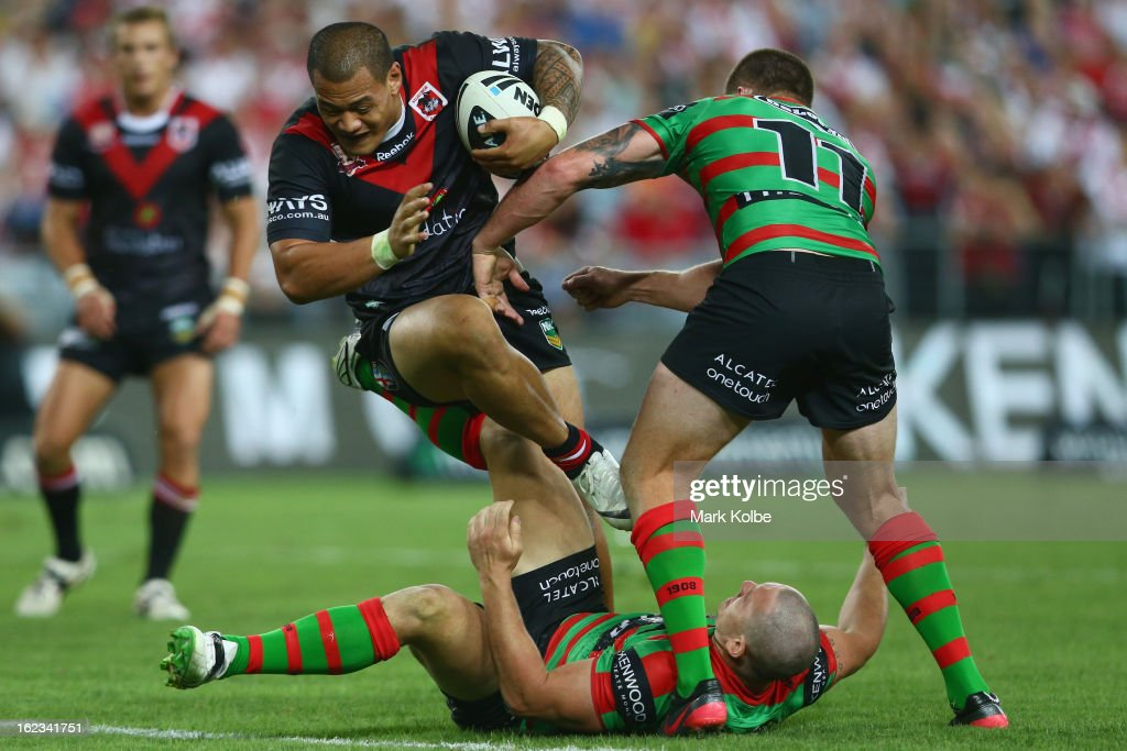Leeson Ah Mau of the Dragons is tackled during the NRL Charity Shield match between the South Sydney Rabbitohs and the St George Illawarra Dragons at ANZ Stadium on February 22, 2013 in Sydney, Australia.