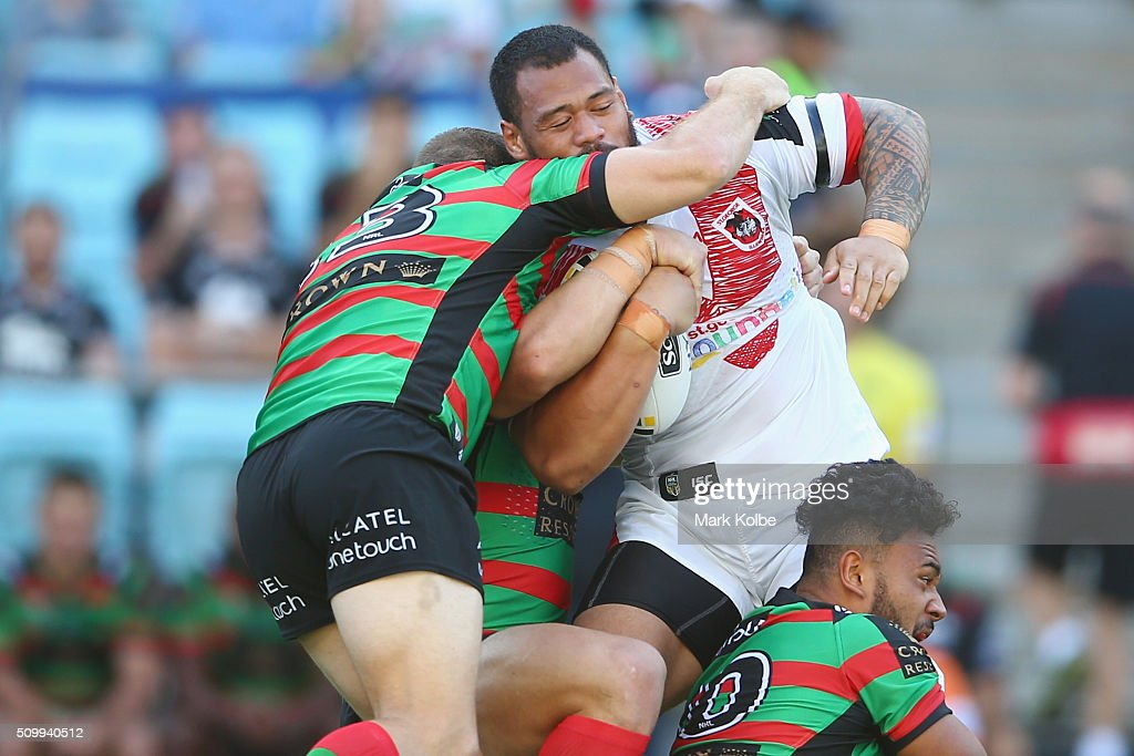 Leeson Ah Mau of the Dragons is tackled during the NRL Charity Shield match between the St George Illawarra Dragons and the South Sydney Rabbitohs at ANZ Stadium on February 13, 2016 in Sydney, Australia.