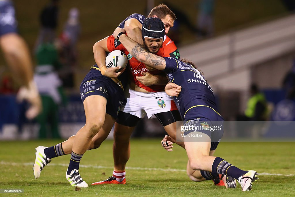 Leeson Ah Mau of the Dragons is tackled during the round 12 NRL match between the St George Illawarra Dragons and the North Queensland Cowboys at WIN Jubilee Stadium on May 28, 2016 in Wollongong, Australia.