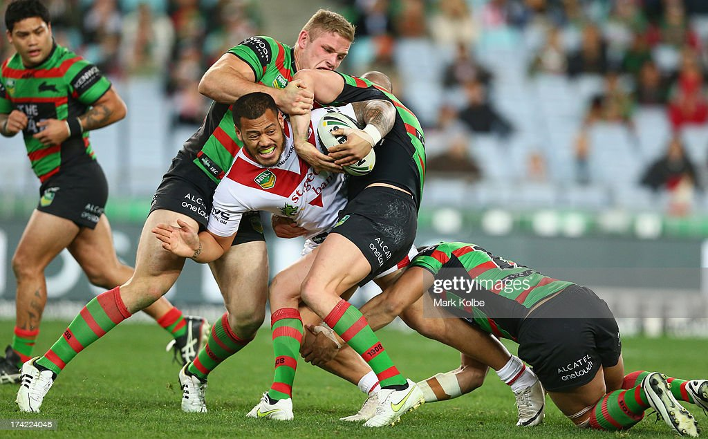 Leeson Ah Mau of the Dragons is tackled during the round 19 NRL match between the South Sydney Rabbitohs and the St George Illawarra Dragons at ANZ Stadium on July 22, 2013 in Sydney, Australia.