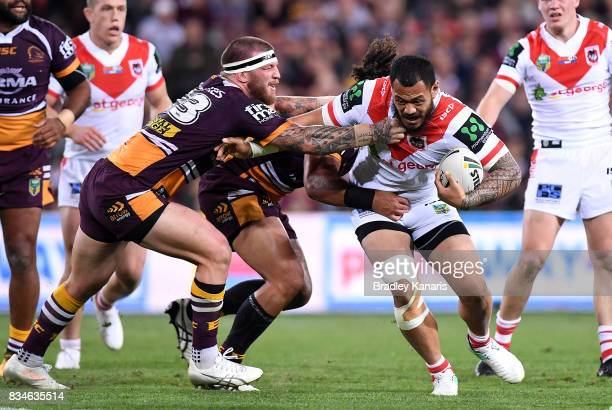 Leeson Ah Mau of the Dragons takes on the defence during the round 24 NRL match between the Brisbane Broncos and the St George Illawarra Dragons at...