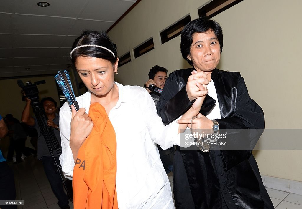 Leeza Ormsby of New Zealand is escorted by a prosecutor after her trial at a Denpasar court on Bali island on July 2 2014 Indonesian judges have...