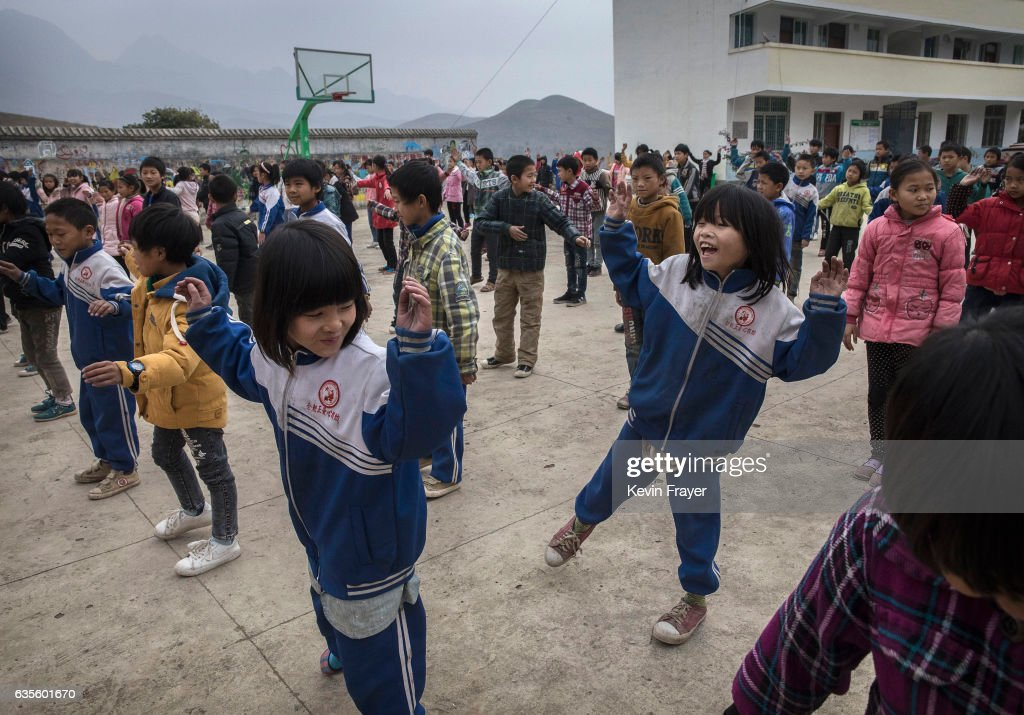 Luo Hangni, 11, right, does exercises with classmates at a local school. Photo by Kevin Frayer/Getty Images