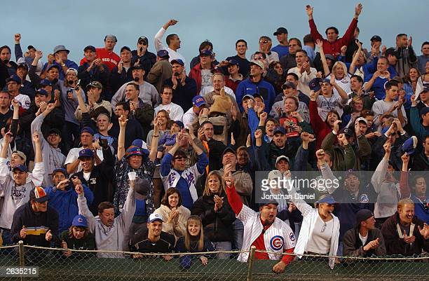Left field bleacher fans of the Chicago Cubs celebrate a win over the Pittsburgh Pirates that clinched the National League Central Division...