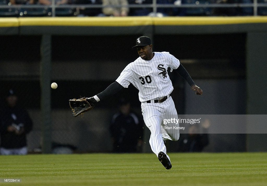 Left fielder <a gi-track='captionPersonalityLinkClicked' href=/galleries/search?phrase=Alejandro+De+Aza&family=editorial&specificpeople=4181650 ng-click='$event.stopPropagation()'>Alejandro De Aza</a> #30 of the Chicago White Sox cannot get to an RBI double hit by Lonnie Chisenhall #8 of the Cleveland Indians scoring teammate Jason Giambi during the second inning on April 22, 2012 at U.S. Cellular Field in Chicago, Illinois.