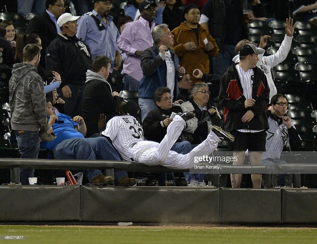 Left fielder Alejandro De Aza #30 of the Chicago White Sox flies into the stands while chasing a pop foul hit by Nick Swisher #33 of the Cleveland Indians during the sixth inning at U.S. Cellular Field on April 11, 2014 in Chicago, Illinois.