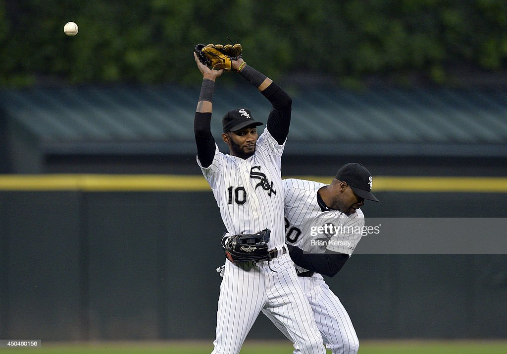 Left fielder <a gi-track='captionPersonalityLinkClicked' href=/galleries/search?phrase=Alejandro+De+Aza&family=editorial&specificpeople=4181650 ng-click='$event.stopPropagation()'>Alejandro De Aza</a> #30 of the Chicago White Sox (R) runs into shortstop <a gi-track='captionPersonalityLinkClicked' href=/galleries/search?phrase=Alexei+Ramirez&family=editorial&specificpeople=690568 ng-click='$event.stopPropagation()'>Alexei Ramirez</a> #10 as he tries to catch a popup hit by Rajai Davis #20 of the Detroit Tigers during the third inning at U.S. Cellular Field June 11, 2014 in Chicago, Illinois. Davis was safe at first on the Ramirez error, but Ramirez was able to recover and throw to second to force out Eugenio Suarez #30 of the Detroit Tigers.