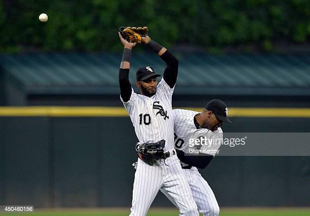Left fielder Alejandro De Aza of the Chicago White Sox runs into shortstop Alexei Ramirez as he tries to catch a popup hit by Rajai Davis of the...