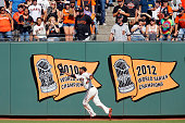 Left fielder Alejandro De Aza of the San Francisco Giants catches a deep fly ball to the wall against Cristhian Adames of the Colorado Rockies in the...