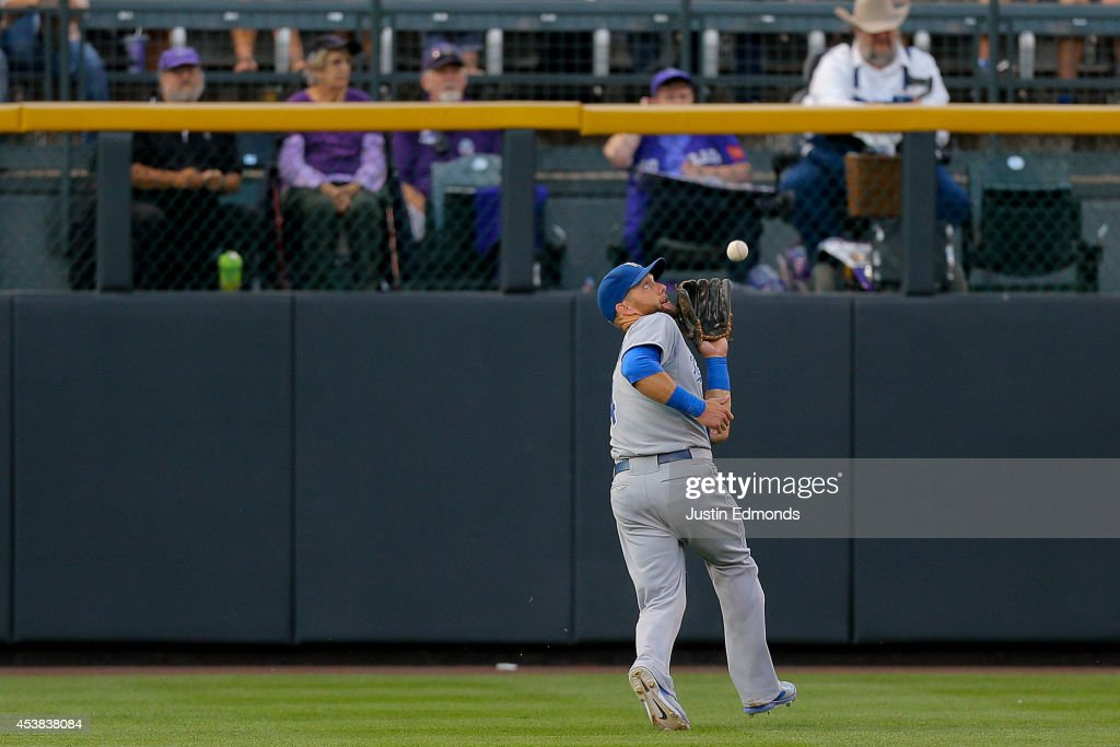 Left fielder <a gi-track='captionPersonalityLinkClicked' href=/galleries/search?phrase=Alex+Gordon+-+Baseball+Player&family=editorial&specificpeople=4494252 ng-click='$event.stopPropagation()'>Alex Gordon</a> #4 of the Kansas City Royals makes a catch for the first out of the second inning against the Colorado Rockies at Coors Field on August 19, 2014 in Denver, Colorado.