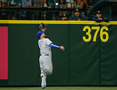 Left fielder Alex Gordon of the Kansas City Royals makes a running catch on a ball off the bat of Seth Smith of the Seattle Mariners for the second...