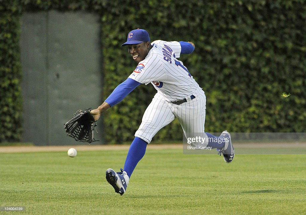 Left fielder <a gi-track='captionPersonalityLinkClicked' href=/galleries/search?phrase=Alfonso+Soriano&family=editorial&specificpeople=202251 ng-click='$event.stopPropagation()'>Alfonso Soriano</a> #12 of the Chicago Cubs cannot get to a triple hit by Joey Votto #19 of the Cincinnati Reds during the first inning at Wrigley Field on September 7, 2011 in Chicago, Illinois.