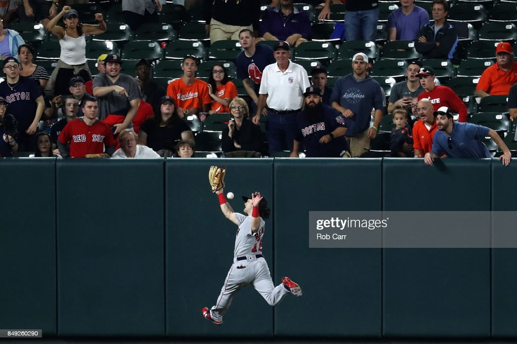 Left fielder Andrew Benintendi #16 of the Boston Red Sox misses a RBI double hit by Austin Hays #18 of the Baltimore Orioles (not pictured) in the fifth inning at Oriole Park at Camden Yards on September 18, 2017 in Baltimore, Maryland.