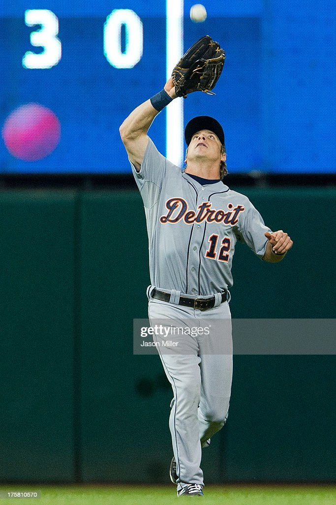 Left fielder <a gi-track='captionPersonalityLinkClicked' href=/galleries/search?phrase=Andy+Dirks&family=editorial&specificpeople=7511216 ng-click='$event.stopPropagation()'>Andy Dirks</a> #12 of the Detroit Tigers catches a fly ball hit by Carlos Santana #41 of the Cleveland Indians during the seventh inning at Progressive Field on August 8, 2013 in Cleveland, Ohio.