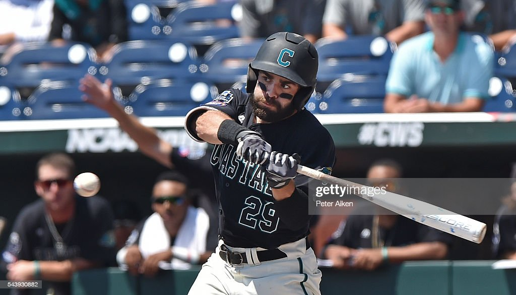 Left fielder Anthony Marks #29 of the Coastal Carolina Chanticleers singles against the Arizona Wildcats in the first inning during game three of the College World Series Championship Series on June 30, 2016 at TD Ameritrade Park in Omaha, Nebraska.