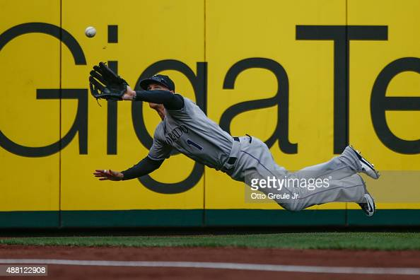 Left fielder Brandon Barnes of the Colorado Rockies makes a diving catch on a ball off the bat of Kyle Seager of the Seattle Mariners in the eighth...