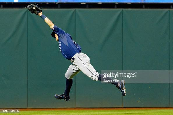 Left fielder Brandon Guyer of the Tampa Bay Rays catches a fly ball hit by Jason Kipnis of the Cleveland Indians during the seventh inning at...