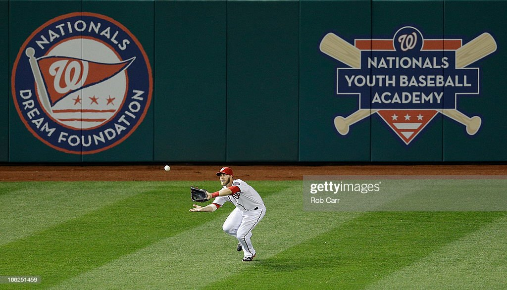 Left fielder <a gi-track='captionPersonalityLinkClicked' href=/galleries/search?phrase=Bryce+Harper&family=editorial&specificpeople=5926486 ng-click='$event.stopPropagation()'>Bryce Harper</a> #34 of the Washington Nationals catches a ball hit by Paul Konerko #14 of the Chicago White Sox for the second out of the ninth inning during the Nationals 5-2 win at Nationals Park on April 10, 2013 in Washington, DC.